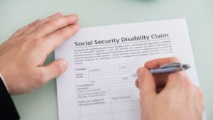 A person filling out an SSDI form.