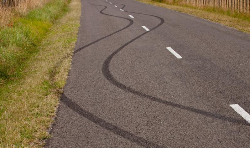 Tire marks on a road due to an auto accident
