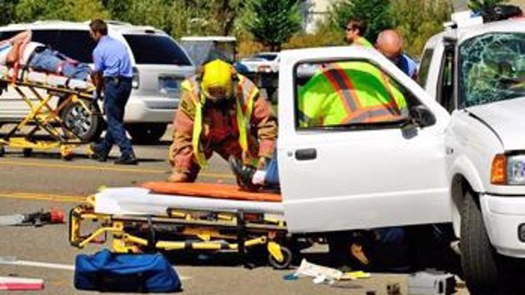 Emergency workers helping people involved in a car accident