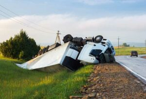 Image showing a truck flipped over after an accident