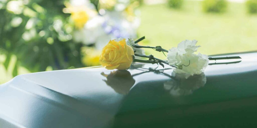 Picture of a funeral after a Watershed employee dies in freak accident