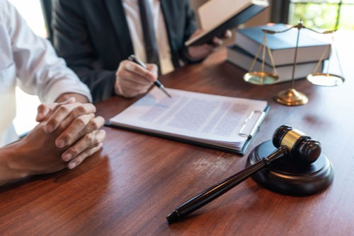 Charlotte speeding accident lawyer discussing evidence for case with client