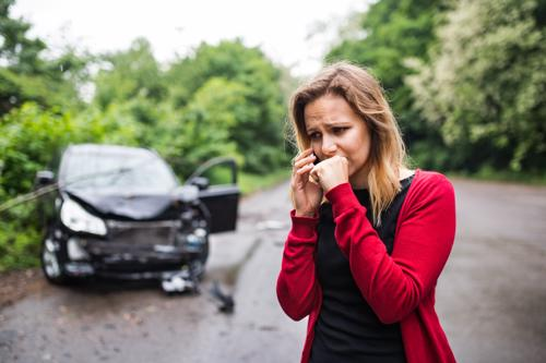A woman calling an attorney after a hit and run accident.