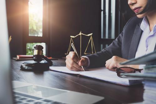 An attorney filing a claim for a client who was in an accident with a speeding driver.