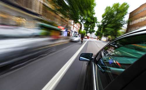 Speeding car, concept of Wilmington reckless driving accident lawyer